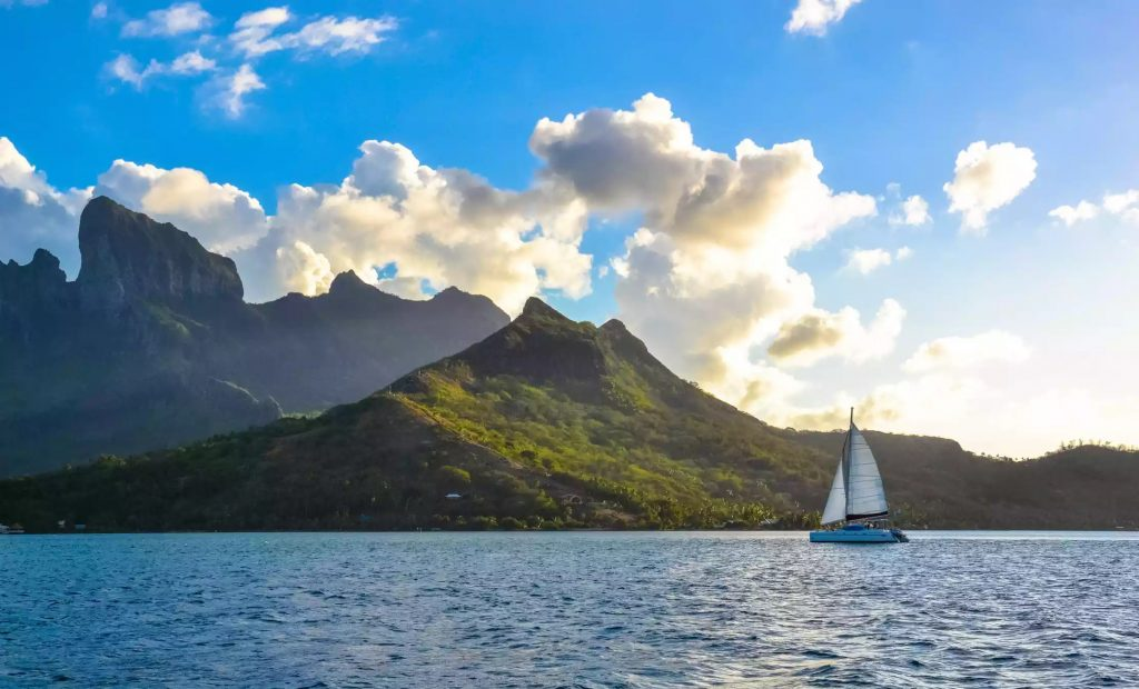 Sailboat in the seas of the French Polynesian Islands.