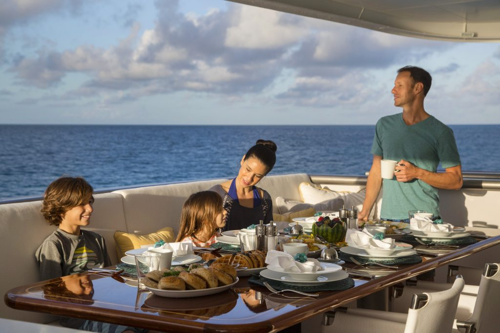 family breakfast on a yacht charter